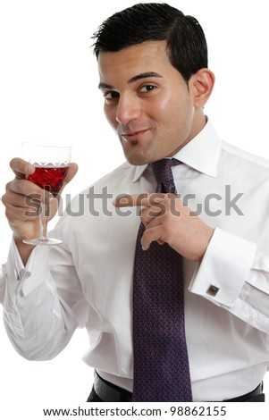 A man holding a glass of red wine and recommending it after tasting.  White background. - stock photo
