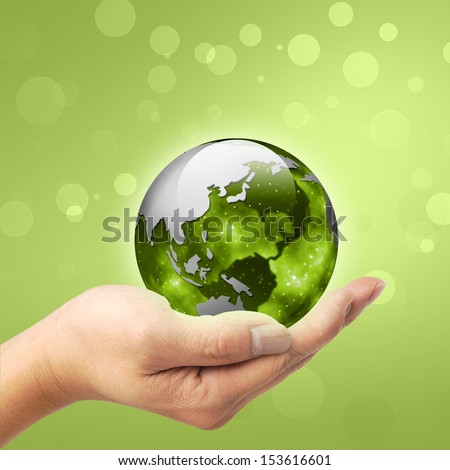 A man holding a globe on his hand - stock photo