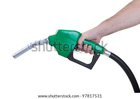 A man holding a green gasoline nozzle on a white background. - stock photo