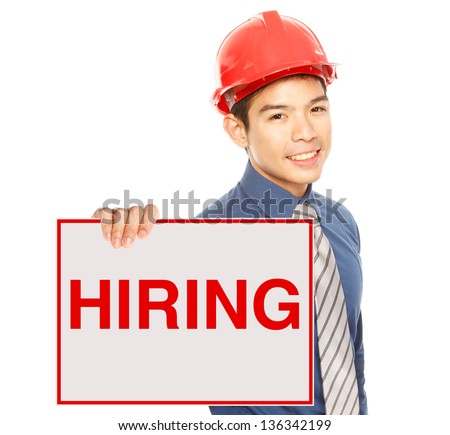 A man holding a job hiring signboard or poster