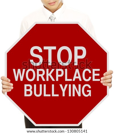 A man holding a modified stop sign on workplace bullying - stock photo