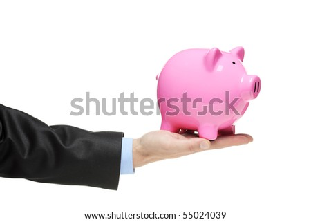 A man holding a Piggy bank isolated on white background - stock photo
