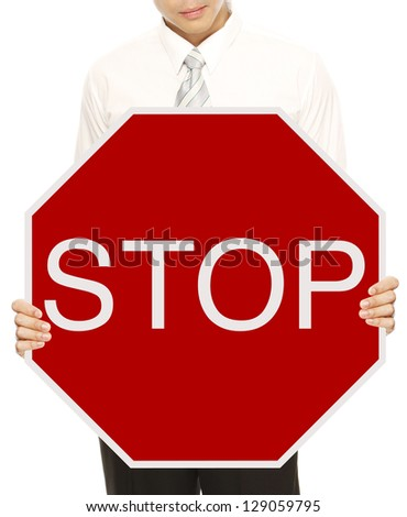 A man holding a Stop sign - stock photo
