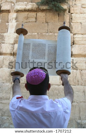 A Man Holding A Torah Scroll at the Western Wall - stock photo
