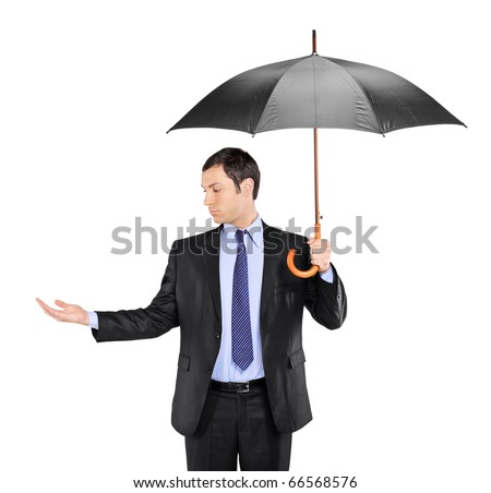 A man holding an umbrella and checking for rain isolated on white background - stock photo