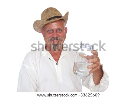 A Man Holding His Bottle of Moonshine - stock photo