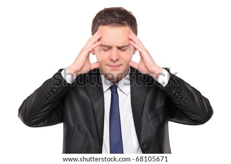 A man holding his head in pain as a result of a headache isolated on white background - stock photo