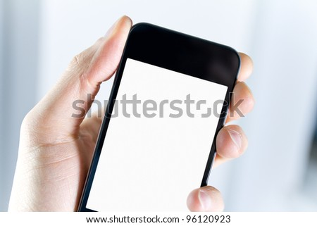 A man holding modern smart phone with blank screen in hand. Closeup shot. - stock photo