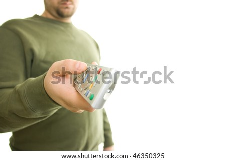 a man holding remote control - stock photo