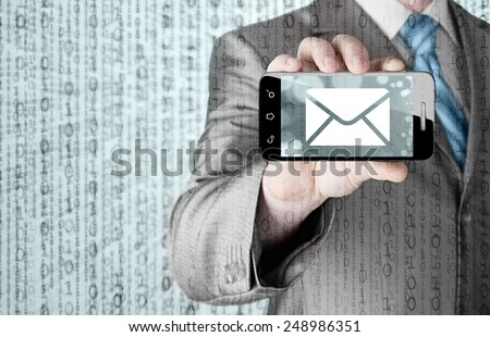A man holding smartphone with one new message on a screen. Closeup shot - stock photo