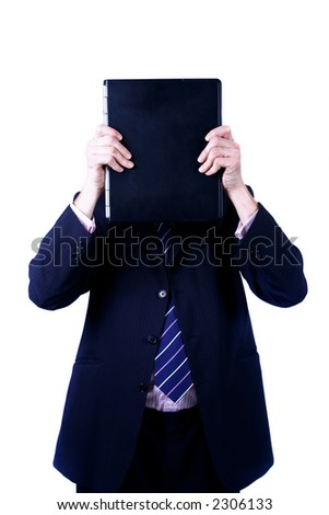 A man holding up a laptop ahead of him. Concept of modern technology. - stock photo