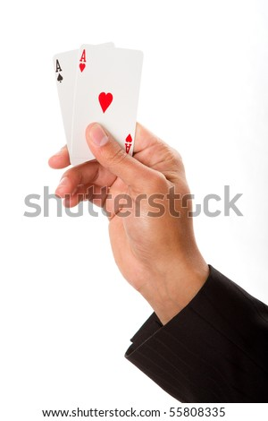A man holding up a pair of aces