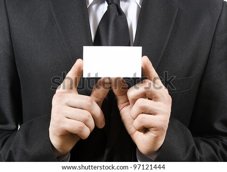 a man holds, a business card isolated on a white background - stock photo