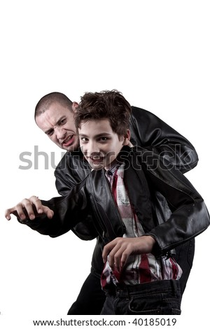A man holds back his son - stock photo