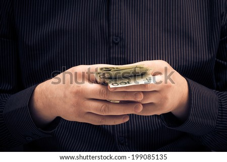 A man holds in the hands of Polish money - stock photo