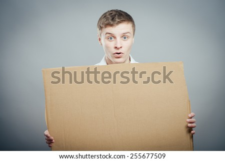 A man holds  poster, billboard, blank - stock photo