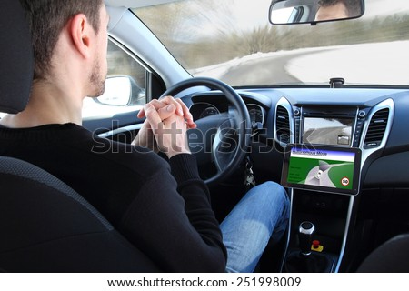 A man in a Autonomous driving  test vehicle - stock photo