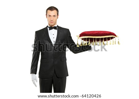A man in a black suit holding a pillow isolated on white background - stock photo