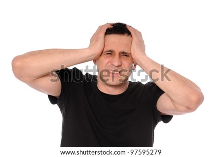 a man in a black t-shirt clings to head in his hands - stock photo