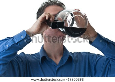 A man in a blue dress shirt, drinking from a coffee pot, isolated on white.