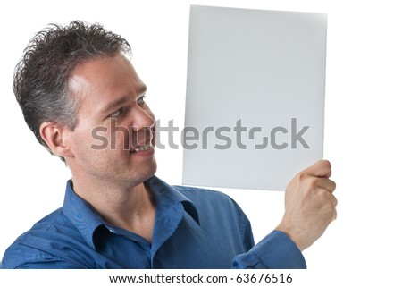 A man in a blue dress shirt, holding a blank white sign, isolated on white. - stock photo