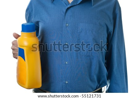 A man in a blue dress shirt, holding a bottle of detergent in a yellow bottle, isolated on white. - stock photo
