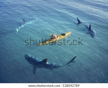A man in a boat, kayak. was trapped in the middle of the ocean surrounded by sharks. - stock photo