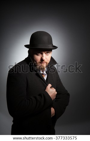 A man in a bowler hat with a beard