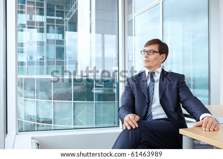 A man in a business suit at the office - stock photo