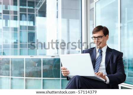 A man in a business suit in the office - stock photo