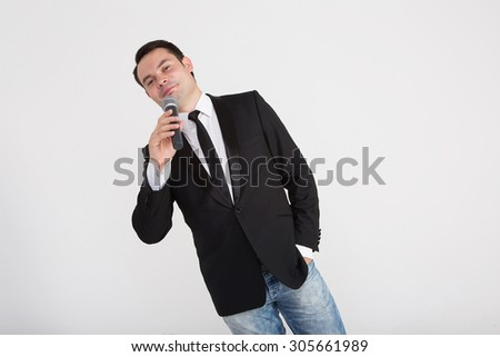 a man in a business suit talking on the phone on white background