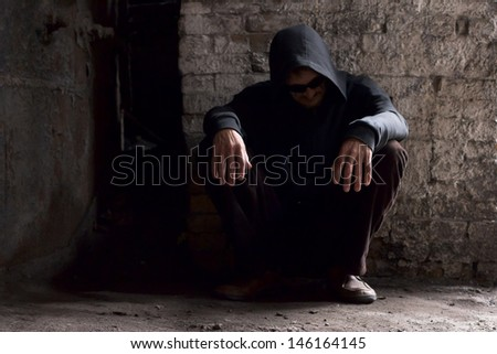 A man in a depression on the streets. - stock photo