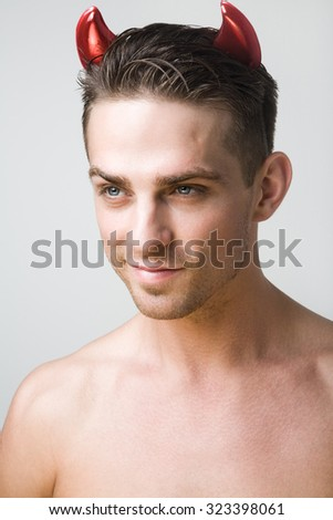 A man in a devil costume on Halloween - stock photo