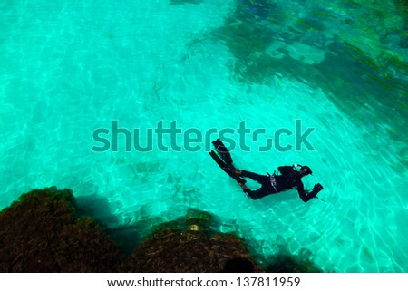 a man in a diving suit swims in the sea, top view. Activities on the water