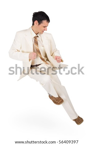 A man in a dynamic pose - high jump on white - stock photo