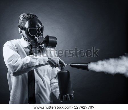a man in a gas mask and a fire extinguisher in his hands