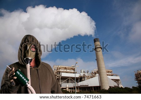 a man in a Gas Mask tries to smoke a cigarette infront of an industrial smoke stack representing Global Warming and Anti-Smoking Message at the same time