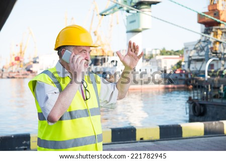 a man in a helmet speaks on the phone - stock photo