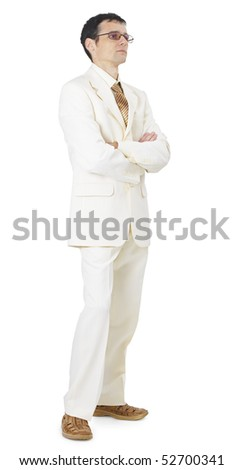 A man in a light business suit standing on white background