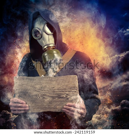 A man in a mask and with a board in the hands of - stock photo