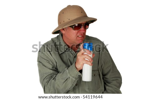 a man in a pith Helmet sprays bug spray or air freshener isolated on white with room for your text or images - stock photo
