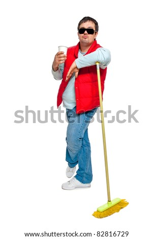 A man in a red jacket with broom poses in the studio on a white background - stock photo