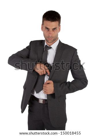 A man in a suit grabbing a gun out his  isolated on white