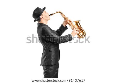 A man in a suit playing on saxophone isolated against background - stock photo