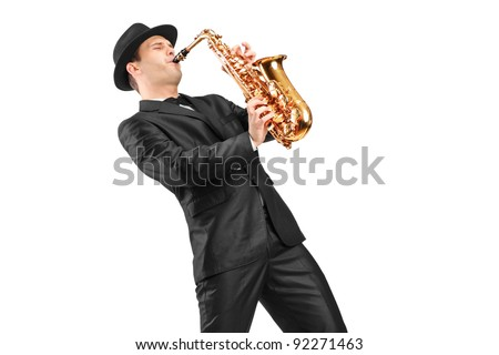 A man in a suit playing on saxophone isolated on background - stock photo