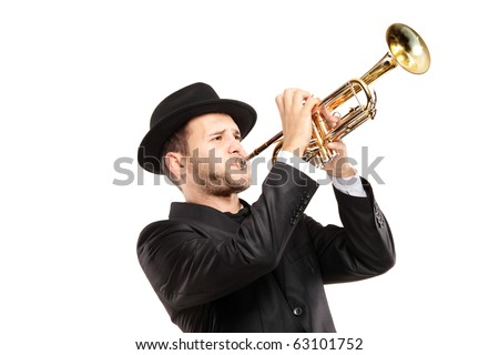A man in a suit with a hat playing a trumpet isolated on white background - stock photo