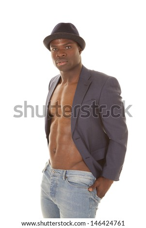A man in a suitcoat with no shirt on serious. - stock photo