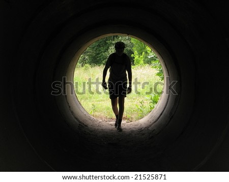 A man in a tunnel