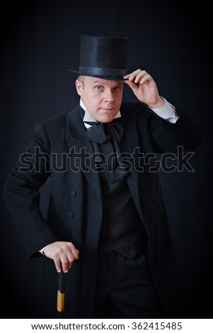 a man in a vintage tuxedo and hat