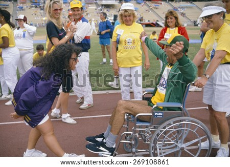 A man in a wheelchair competes at the Special Olympics,  - stock photo